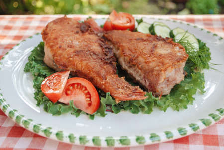 Food photo. Fried fish with vegetables, close-up