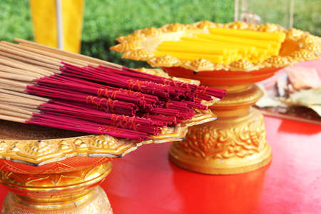 Asia. Candles and flavored sticks in Thailand, close-up
