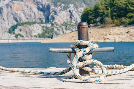 Boat trips in Turkey. Mooring bollard with rope, close-up Stock Photo