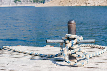 Water trips in Turkey. Mooring bollard with rope, close-up