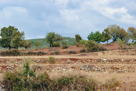 Traveling. Turkish rural landscape. View on red clay and stones