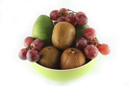 Fruits in a bowl isolated on a white background