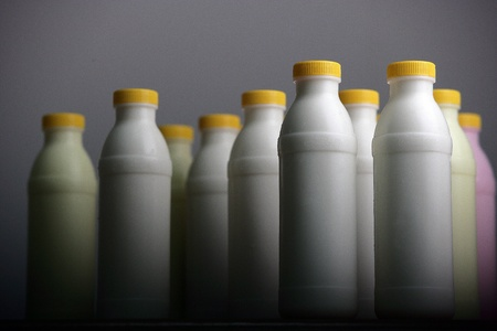lined up: lined up of a milk bottle Stock Photo