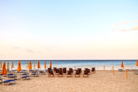 loungers: sun loungers at the beach of Mondello in Sicily, Italy