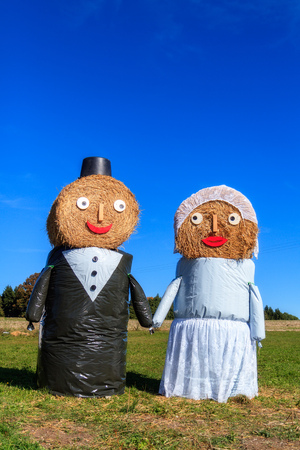 Marriage Tradition in Bavaria  Lovely Bridal Couple Puppets made out of Hay Bale with Suit and Wedding Dress in Europe in Autumn photo