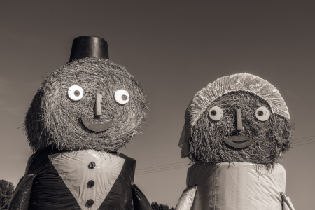 Marriage Tradition in Bavaria  Lovely Bridal Couple Puppets made out of Hay Bale with Suit and Wedding Dress in Europe in Autumn Stock Photo - 22737401