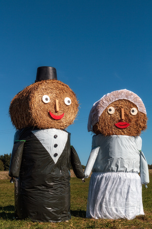Marriage Tradition in Bavaria  Lovely Bridal Couple Puppets made out of Hay Bale with Suit and Wedding Dress in Europe in Autumn Stock Photo - 22737403