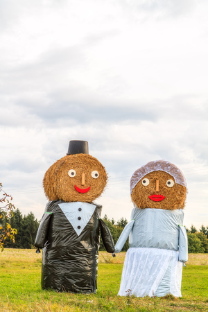 Marriage Tradition in Bavaria  Lovely Bridal Couple Puppets made out of Hay Bale with Suit and Wedding Dress in Europe in Autumn Stock Photo - 22737406