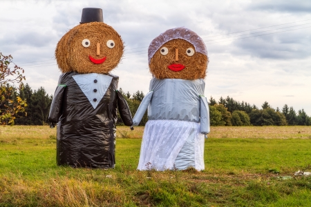Marriage Tradition in Bavaria  Lovely Bridal Couple Puppets made out of Hay Bale with Suit and Wedding Dress in Europe in Autumn Stock Photo - 22737408