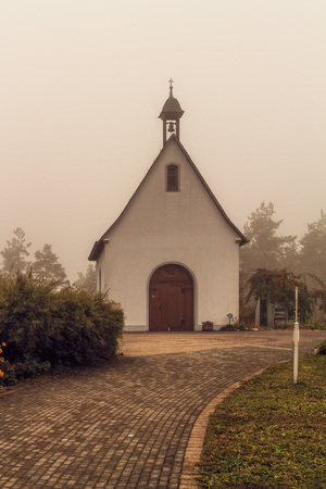brownish: Suspenseful Foggy Autumn Scenery at a mountain monastery in Bavaria, Germany   Europe  Stratus in the mountains in an amazing misty landscape