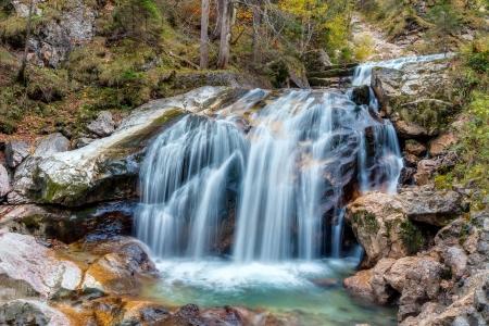 Valley with Watercourse and Waterfalls in Autumn near Neuschwanstein, Germany, taken in autumn October photo