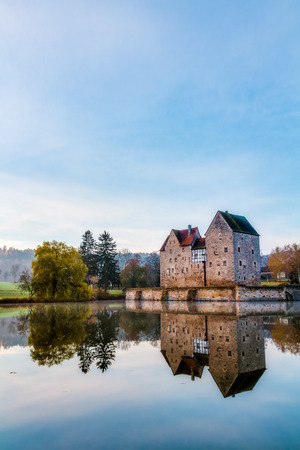 Medieval Water Castle Brennhausen in German Bavaria, shot on a warm autumn morning