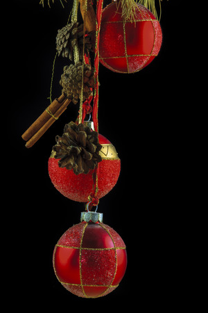 Isolated red Christmas Baubles on mono colored background with Cinnamon and other decorations photo