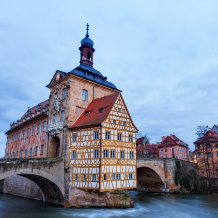 Famous Old City Hall of Bamberg on the river Regnitz in the morning hours in Bavaria   Germany  Picture was taken in the blue hour before sunrise photo