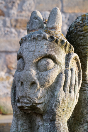 grotesque: Stone Gargoyle at the medieval castle ruin Giechburg  Travel Picture was taken on a winter morning Stock Photo