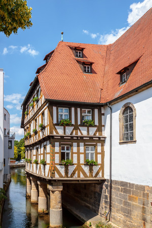 half  timbered: Half Timbered House on a River in the German City of Forchheim in Oberfranken, Bavaria Editorial