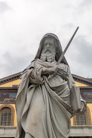 paulus: Statue of St. Paul with his sword in front of the Church St. Paul outside of the Walls of Rome Stock Photo