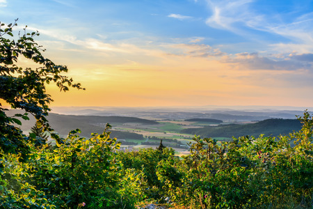 Idyllic Bavarian Rural Countryside Summer Landscape. Picturesque Hills in Upper Franconia, Germany. Villages and rocky terrain at the jurassic mountains with green forrest photo