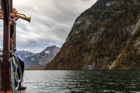 Trumpeter for the famous echo at the sea of kings in Berchtesgaden in Bavaria, Germany photo