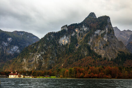 Idyllic Autumn Scenery at the lovely sea of kings in Berchtesgaden, Germany. Lovely colorful trees in Bavaria photo