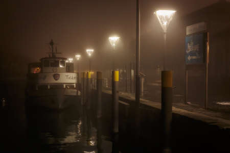 baden wurttemberg: CONSTANCE, GERMANY - NOVEMBER 02 2014: Harbor at Lake Constance in Autumn. Lovely atmosphere in the german city of Constance in Baden Wurttemberg. Foggy Night Atmosphere Editorial