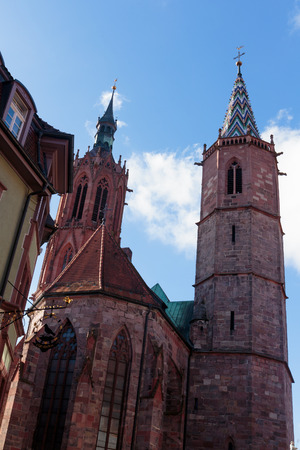 baden wurttemberg: Outside Shot of the Cathedral of Villingen with famous towers on a warm autumn day in Baden Wurttemberg, Germany in the black forest. Blue Sky with some clouds