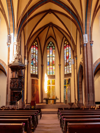 baden wurttemberg: OFFENBURG, GERMANY - NOVEMBER 09 2014: Interior Picture of a lovel church in Offenburg in Baden Wurttemberg, Germany. Warm light