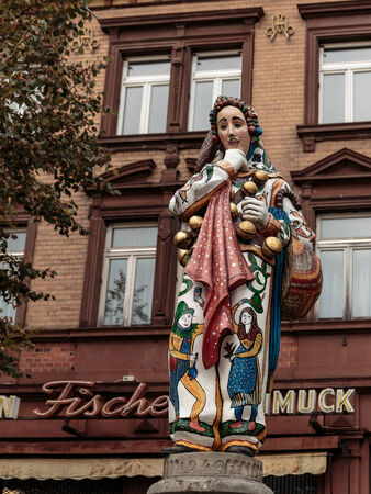 traditional costume: DONAUESCHINGEN, GERMANY - NOVEMBER 05 2014: Statue of a Jester with a Traditional Costume in the Black Forest at Donaueschingen