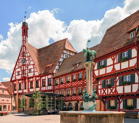 half  timbered: Historical City Hall of Forchheim in german Oberfranken, Bavaria. Picturesque Half Timbered Building with little bell tower. Cloudy sky Stock Photo