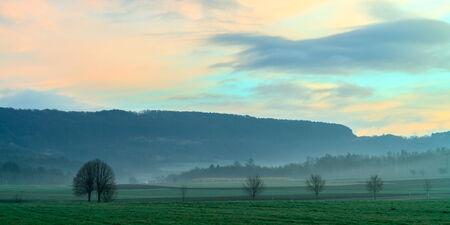 Foggy Bavarian Sunrise. Morning Fog photo
