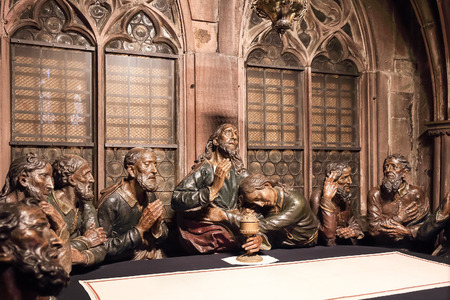 last supper: FREIBURG, GERMANY - DECEMBER 13 2014: German catholic Cathedral of Freiburg interior. Baroque Last Supper Statue Group