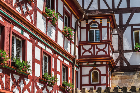 upper half: Forchheim City in german Oberfranken, Bavaria. Picturesque Half Timbered Building
