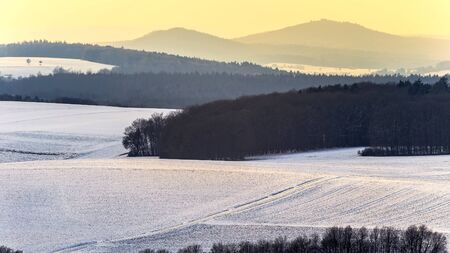 trecking: Cold snowy winter wonderland in the franconian Jura Region of Bavaria, Germany. Sweet Solitude. White and Lonely Landscape Stock Photo