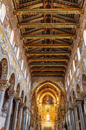pantocrator: MONREALE, PALERMOITALY - JUNE 27 2013:Interior shot of the famous cathedral Santa Maria Nuova of Monreale on June 27 2013 in Monreale near Palermo in Sicily, Italy