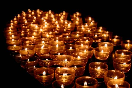 prayer candles: Warm Prayer Candles in a Church