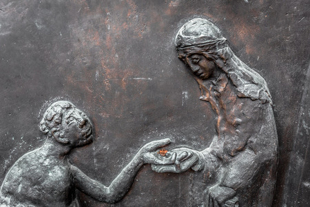WUERZBURG, GERMANY - MARCH 08 2015: Charity Picture from a Door the Catholic Christian Cathedral of Wuerzburg in Bavaria, Germany Redakční