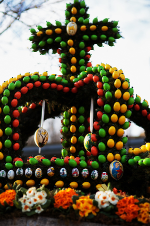 pagan: Franconian Easter Tradition. Masterfully Colored Easter Eggs on a decorated Easter Well. Old german pagan spring ritual of well and water blessing Stock Photo