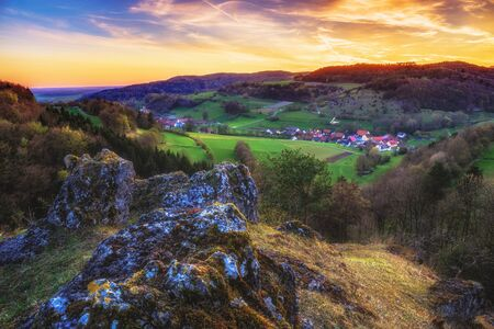jura: Sunset in the jurassic hills of Upper Franconia, Germany. Lovely Spring evening in the rural countryside near Bamberg. European Scenery