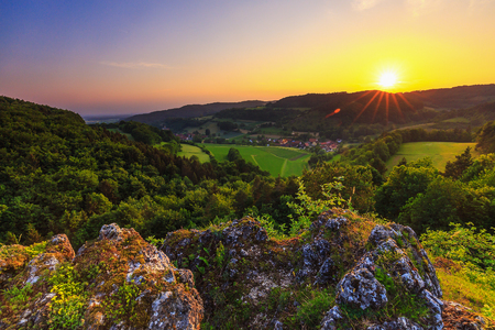 Summer countryside landscape in the Franconian Switzerland Germany. Rocks and hills from an ancient coastline Reklamní fotografie