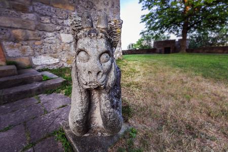 melancholijny: Melancholic Stone Gargoyle in Franconia, Germany