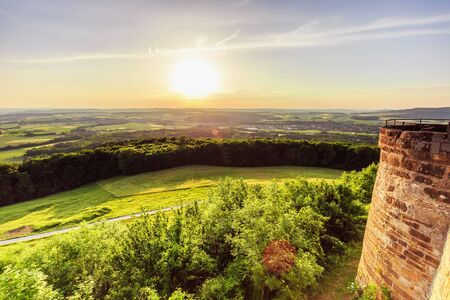 rural countryside: Sunset at Giechburg Castle Ruin in Franconia, Germany. Lovely Summer sunset in the rural countryside of Bavaria on a warm june day. Medieval Architecture and blue sky