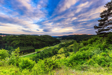 rural countryside: Stunning Summer Evening Landscape in the rural Countryside of Bavaria, Germany. Lovely hills and woods in the franconian switzerland