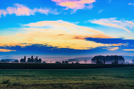 popping: Autumn Sunrise Rural Landscape Panorama. Lovely popping vibrant colors in the fall at dawn in Bavaria, Germany