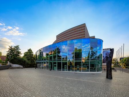 music hall: BAMBERG, GERMANY - JULY 09 2015: Bamberg City Concert Hall. Music Hall on a warm summer evening. Modern Auditorium