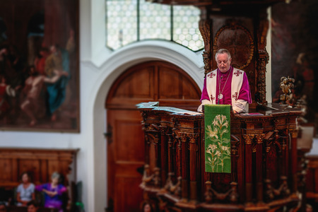 the sermon: AUGSBURG, GERMANY . AUGUST 08 2015: Augsburg City in Bavaria, Germany. Ecumenical Church Service on the anniversary of the Peace of Religions of Augsburg. Sermon on the pulpit Editorial