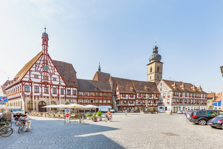 summer heat: FORCHHEIM, GERMANY - August 12 2015: Historical buildings on a hot summer day in the inner city of the Franconian town of Forchheim. Clear blue sky and Summer Heat