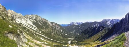 late summer: Austrian Mountain Panorama. Lovely afternoon high mountain landscape  in the Karwendel Mountain Range of Tyrol, Austria near Seefeld on a hot August late summer day