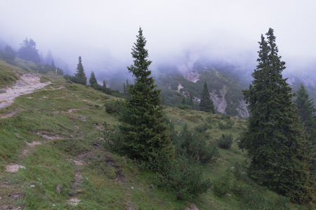 desolate: Karwendel Mountain Range in Tyrol, Austria on a foggy and rainy day in August. High Mountains landscape in a bleak and desolate landscape Stock Photo