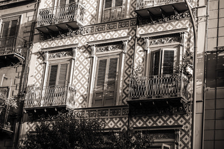mediterranean houses: PALERMO, ITALY - SEPTEMBER 17 2015: Black and White Vintage Picture from the Palermo, the capital of the Island of Sicily in Italy on a hot september day. Lovely mediterranean houses Stock Photo