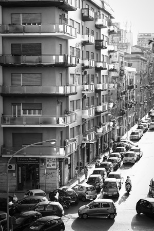 mediterranean houses: PALERMO, ITALY - SEPTEMBER 17 2015: Black and White Vintage Picture from the Palermo, the capital of the Island of Sicily in Italy on a hot september day. Lovely mediterranean houses Editorial